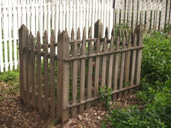Unpainted Picket Fence around a grave