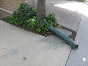 Downspout with plastic extender on Springer