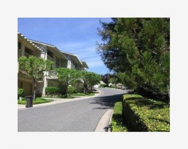 View of street within Saratoga Oaks townhome community in Saratoga, CA