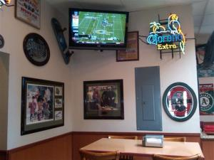 Malibu Grill dining area includes views of sports on TV