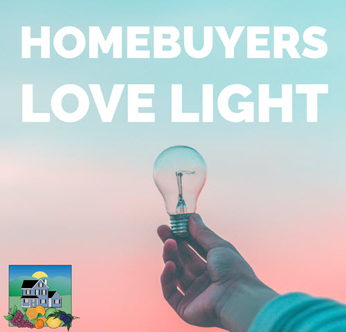 Hand holding lightbulb against pink and blue sky with the words Homebuyers love light