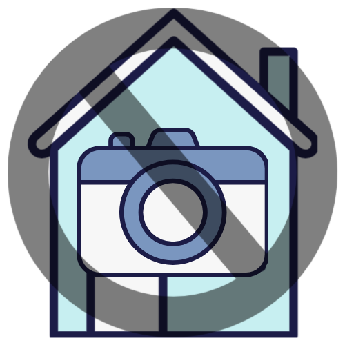 Forbidden symbol over a large camera and a house to represent homes with no or few photographs
