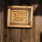 Guglielmo happy tasting room staff sign