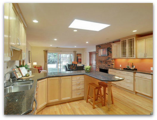 Updated and remodeled kitchen with granite counters, maple cabinets, recessed lights, a big skylight and open layout at 920 Hazelwood Avenue, Campbell CA 95008