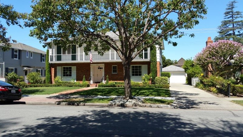 A two story home with a detached garage, which is typical in the Rose garden.