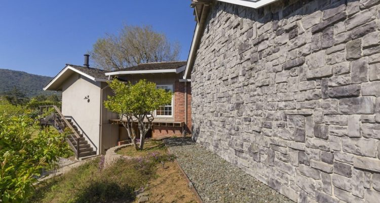 Beautiful stone facing on back of garage wall