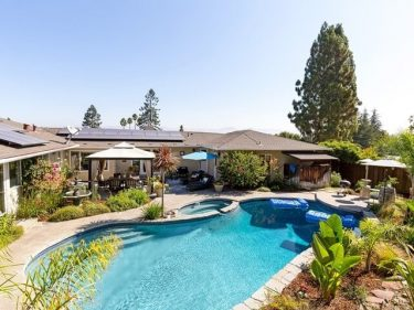 Los Gatos foothills ranch house backyard with patio, pool, and spa