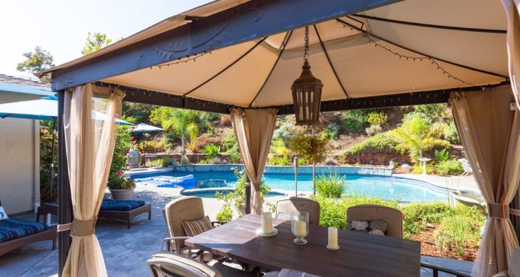 Dining under a canopy by the pool