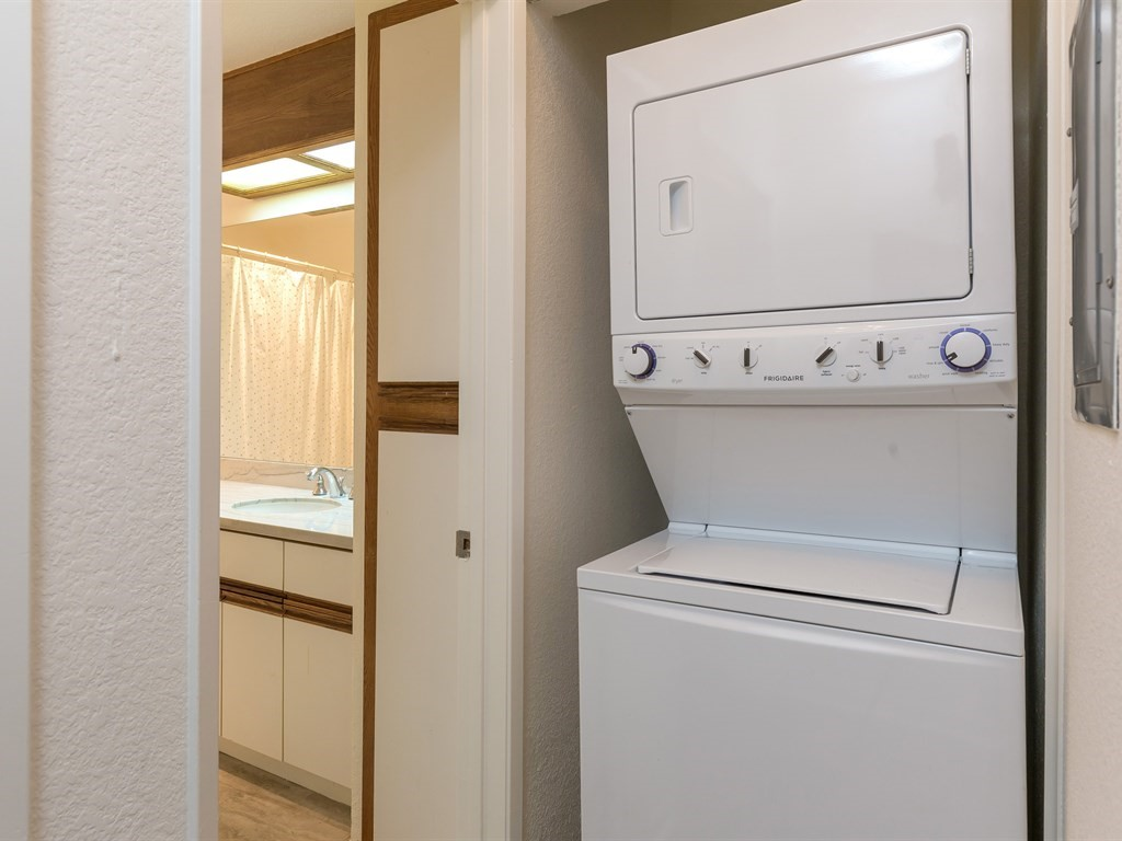 Stacked washer and dryer set - stays with the home
