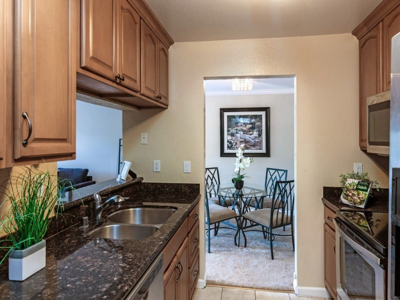 Remodeled kitchen with slab granite counters and brand new oven, microwave, and dishwasher. Fridge included!