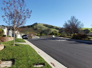 View of a nearby hill from Wine Valley Circle, in Village Olivas at the Villages