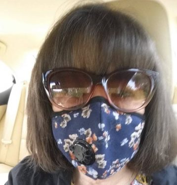 Mary Pope-Handy 2018 photo wearing mask for smoke - same N95 mask can work for Coronavirus