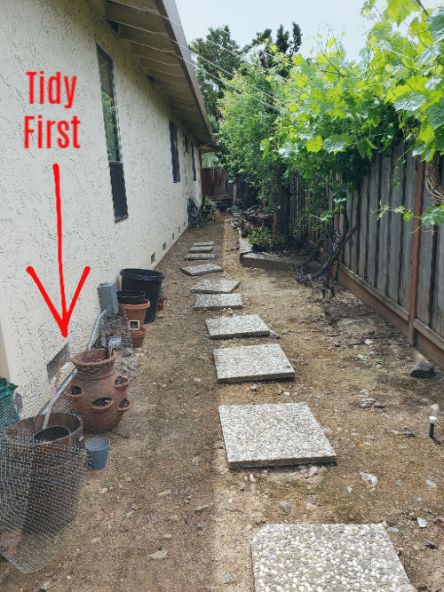 Example of a side yard that should be tidied so that those selling an occupied home can give a better idea of the whole parcel to prospective buyers