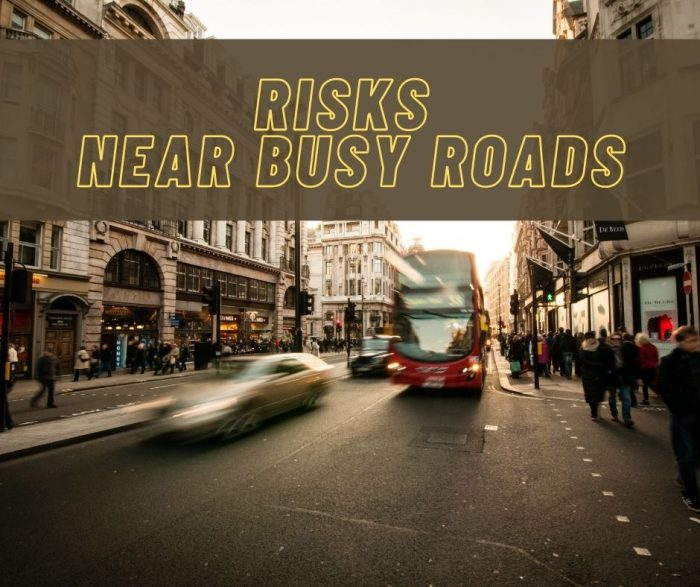 Risks near busy roads graphic - city street with cars and a bus driving fast.
