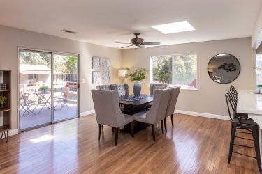 Open living with dining, living, and kitchen making up the great room